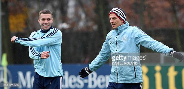 Lukas Podolski and Mario Gomez of the German national football team attend a training session prior to the World Cup qualifyer against Kazakhstan in...