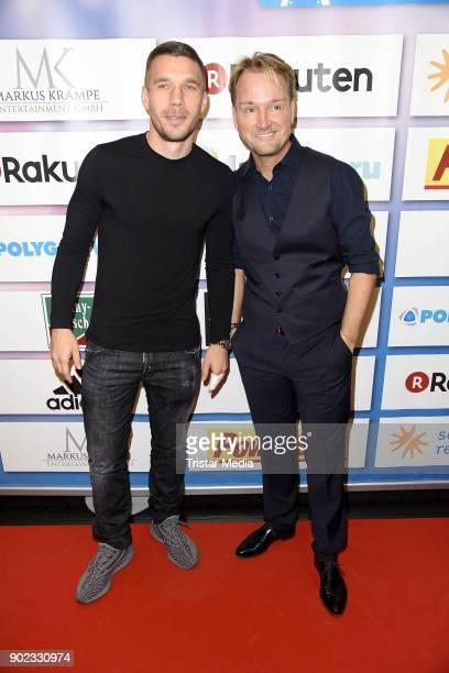 Lukas Podolski and Markus Krampe attend the Schauinsland Reisen Cup 2018 at Schwalbe Arena on January 7 2018 in Gummersbach Germany