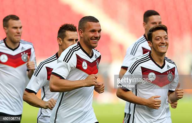 Lukas Podolski and Mesut Oezil look on during the German National team training session at coface Arena on June 5 2014 in Mainz Germany