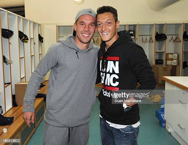 Lukas Podolski and Mesut Ozil of Arsenal pose for a photograph at their training ground on September 11 2013 in London Colney England