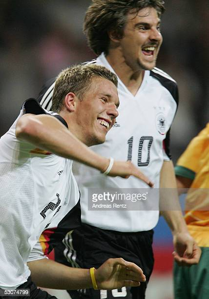 Lukas Podolski and Sebastian Deissler of Germany celebrates after the seventh goal during the FIFA Confederations Cup 2005 match between Germany and...