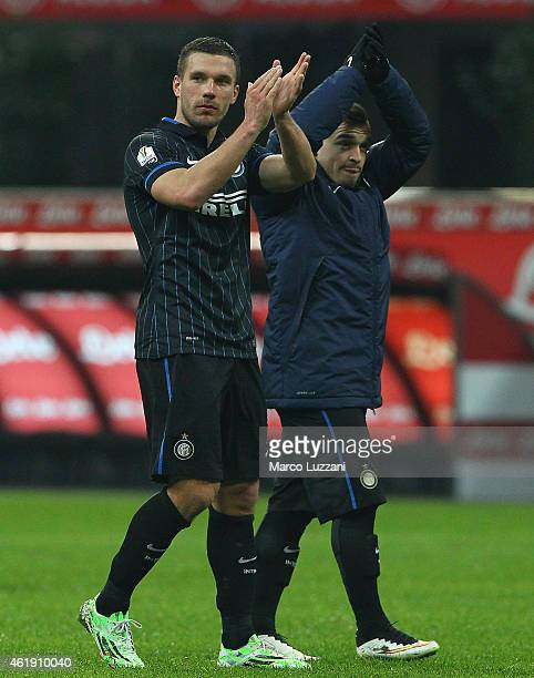 Lukas Podolski and Xherdan Shaqiri of FC Internazionale Milano salute the crowd at the end of the TIM Cup match between FC Internazionale Milano and...
