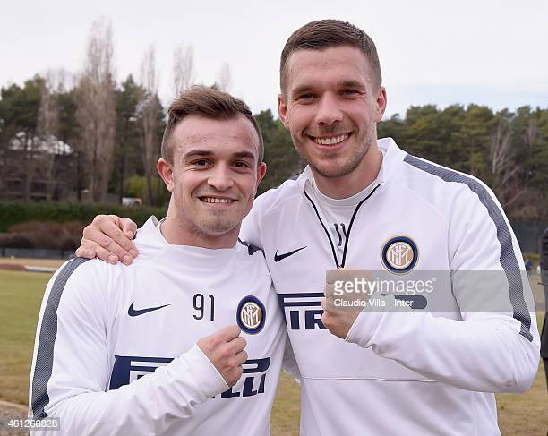 Lukas Podolski and Xherdan Shaqiri pose for a photo during the FC Internazionale Training Session at Appiano Gentile on January 10 2015 in Como Italy
