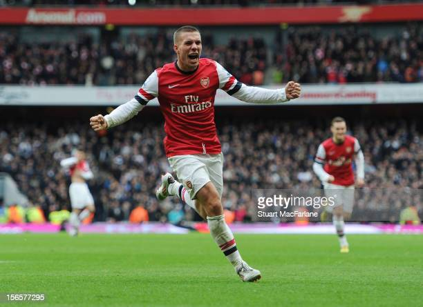 Lukas Podolski celebrates after scoring his team's second goal during the Barclays Premier League match between Arsenal and Tottenham Hotspur at...
