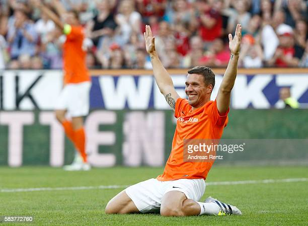 Lukas Podolski celebrates during the 'Champions for charity' football match between Nowitzki All Stars and Nazionale Piloti in honor of Michael...
