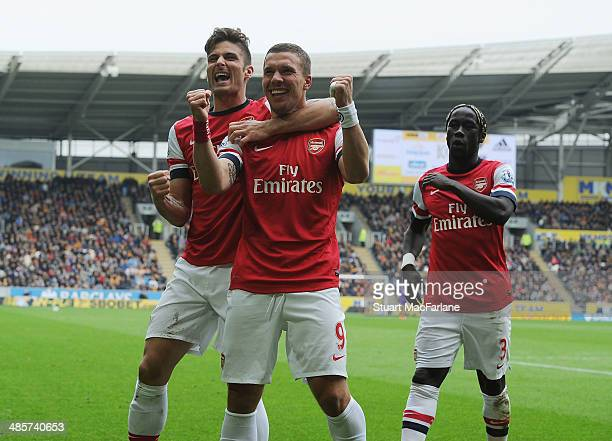 Lukas Podolski celebrates scoring the 3rd Arsenal goal with Olivier Giroud and Bacary Sagna during the Barclays Premier League match between Hull...