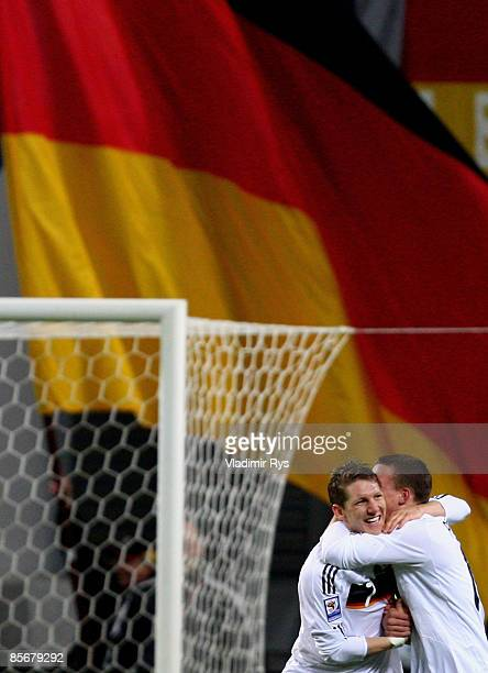 Lukas Podolski celebrates with his team mate Bastian Schweinsteiger of Germany after scoring the 40 goal during the FIFA 2010 World Cup Group 4...