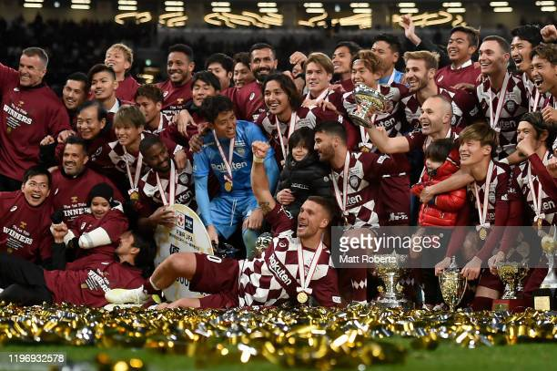 Lukas Podolski celebrates with team mates after the trophy presentation of the 99th Emperor's Cup final between Vissel Kobe and Kashima Antlers at...