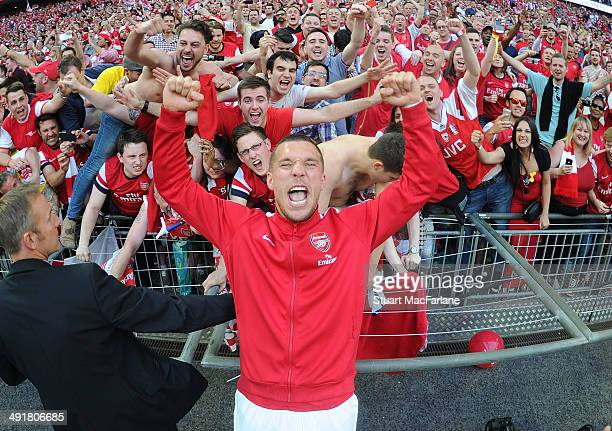 Lukas Podolski celebrates with the Arsenal fans after the FA Cup Final between Arsenal and Hull City at Wembley Stadium on May 17, 2014 in London,...
