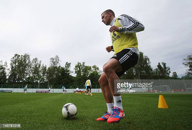 Lukas Podolski controls the ball during a Germany training session at training ground on June 5 2012 in Gdansk Poland