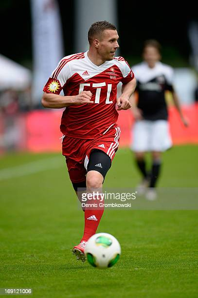 Lukas Podolski controls the ball during the 'Kicken fuer den guten Zweck' event at Sportpark Hoehenberg on May 20 2013 in Cologne Germany