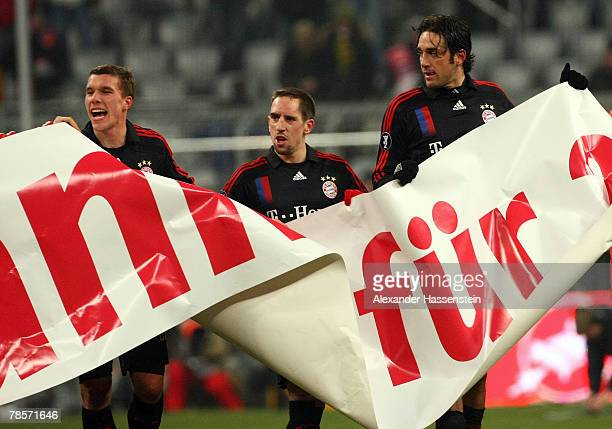 Lukas Podolski Franck Ribery and Luca Toni of Munich showing their sympathy for the Munich supporters after the UEFA Cup Group F match between Bayern...
