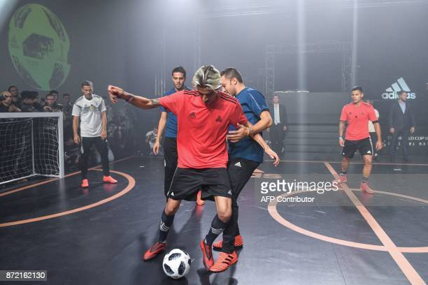 Lukas Podolski Kaka Alessandro Del Piero along with other participants play with the official match ball for the 2018 World Cup football tournament...