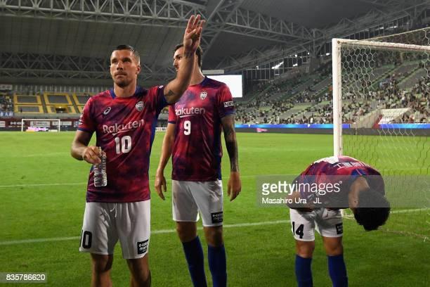 Lukas Podolski Mike Havenaar and Naoyuki Fujita of Vissel Kobe Vissel Kobe applaud supporters after the scoreless draw in the JLeague match between...