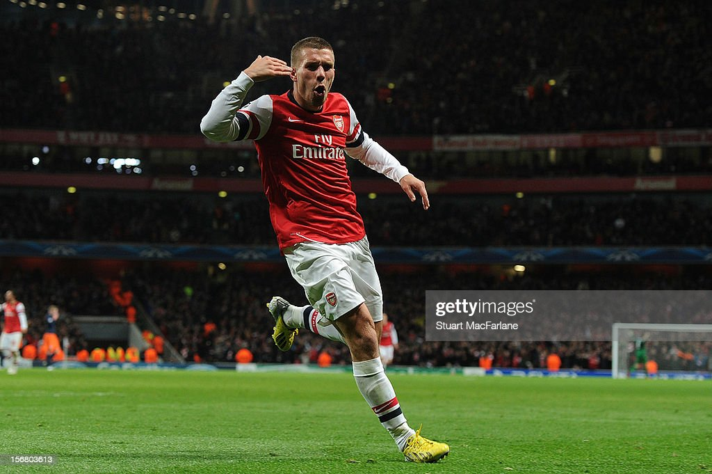 Lukas Podolski of Arsenal celebrates after scoring their second goal during the UEFA Champions League Group B match between Arsenal FC and Montpellier Herault SC at Emirates Stadium on November 21, 2012 in London, England.