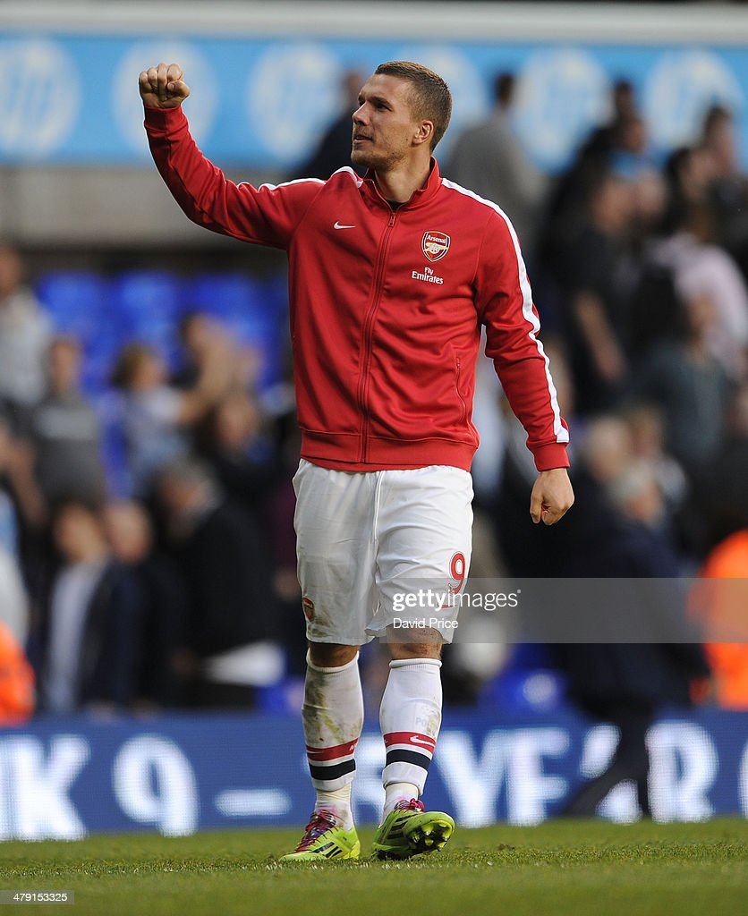 Lukas Podolski of Arsenal celebrates after the match between Tottenham Hotspur and Arsenal in the Barclays Premier League at White Hart Lane on March 16, 2014 in London, England.