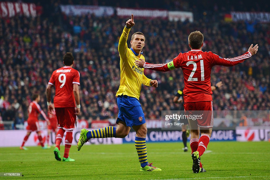 Lukas Podolski of Arsenal celebrates his goal as he goes past Philipp Lahm of Bayern Muenchen during the UEFA Champions League round of 16, second leg match between Bayern Muenchen and Arsenal at Allianz Arena on March 11, 2014 in Munich, Germany.