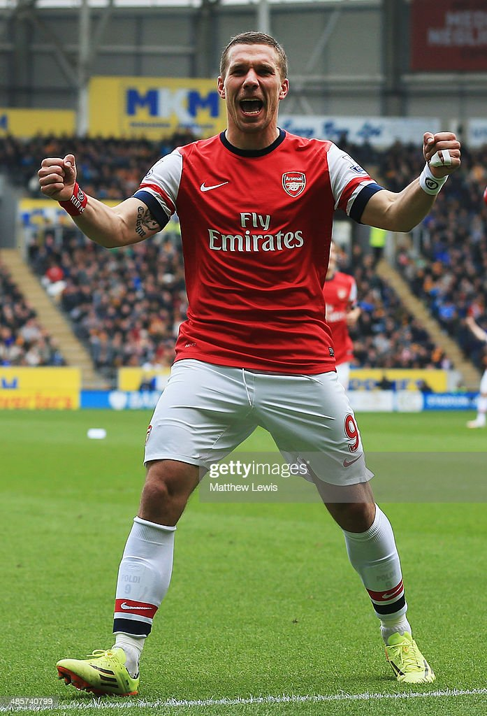 Lukas Podolski of Arsenal celebrates scoring his sides third goal during the Barclays Premier League match between Hull City and Arsenal at KC Stadium on April 20, 2014 in Hull, England.