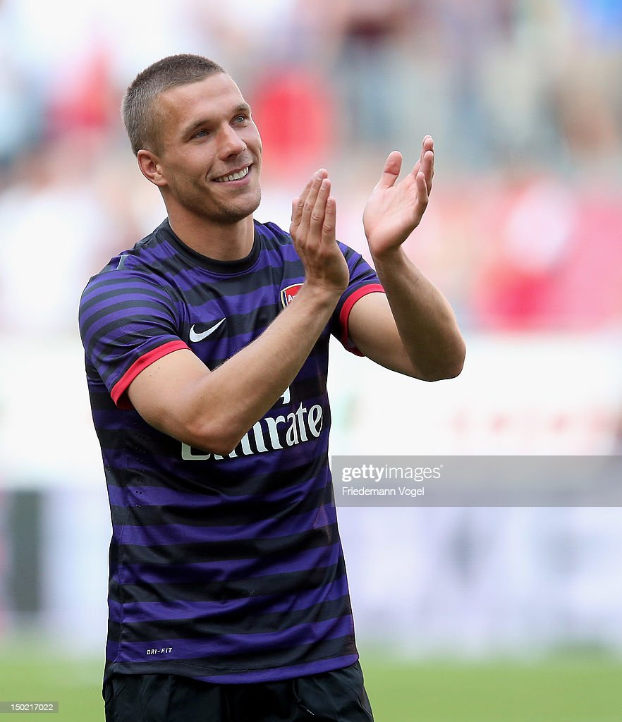 Lukas Podolski of Arsenal celebrates with the fans of Cologne after Pre-Season Friendly game between FC Cologne and FC Arsenal at Rhein Energie Stadium on August 12, 2012 in Cologne, Germany.