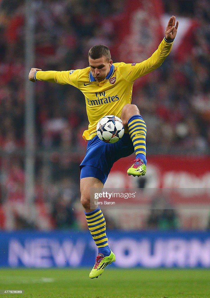 Lukas Podolski of Arsenal controls the ball during the UEFA Champions League round of 16, second leg match between Bayern Muenchen and Arsenal at Allianz Arena on March 11, 2014 in Munich, Germany.