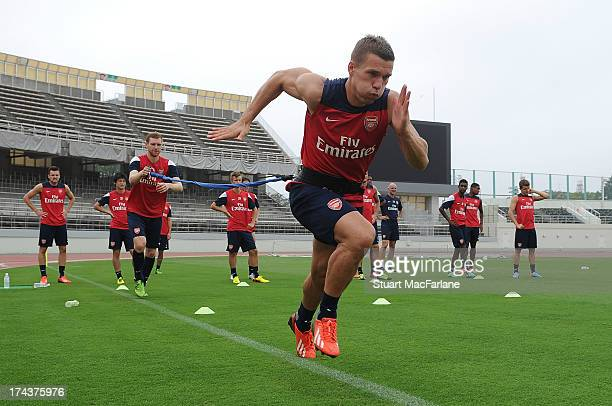 Lukas Podolski of Arsenal during a training session in Saitama, Japan for the club's pre-season Asian tour at the Saitama Stadium on July 25, 2013 in...