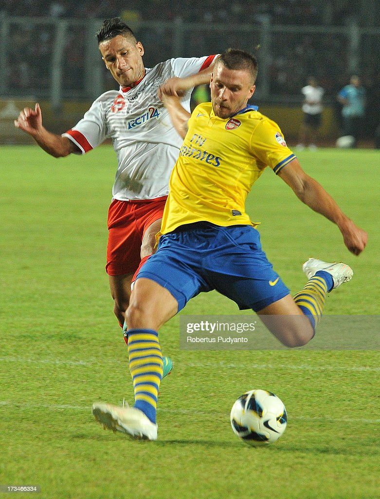 Lukas Podolski of Arsenal FC kicked the ball and made a goal in minute 82 during the match between Arsenal and the Indonesia All-Stars at Gelora Bung Karno Stadium on July 14, 2013 in Jakarta, Indonesia.
