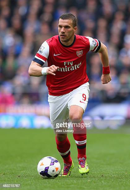 Lukas Podolski of Arsenal in action during the Barclays Premier League match between Everton and Arsenal at Goodison Park on April 6 2014 in...