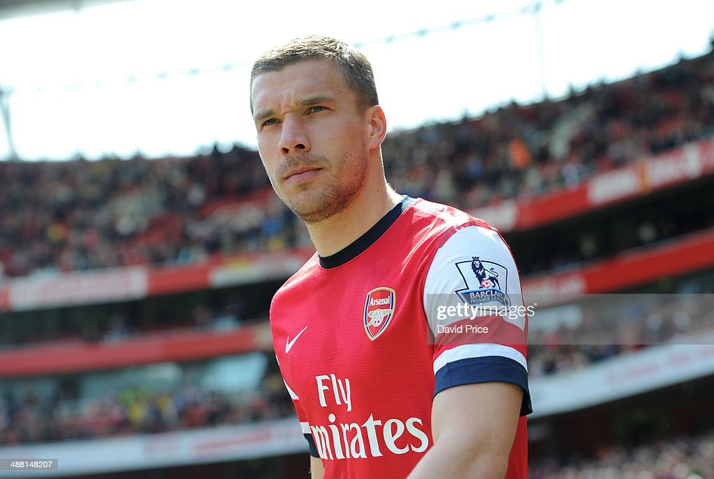 Lukas Podolski of Arsenal looks on before the match between Arsenal and West Bromwich Albion in the Brclays Premier League at Emirates Stadium on May 4, 2014 in London, England.