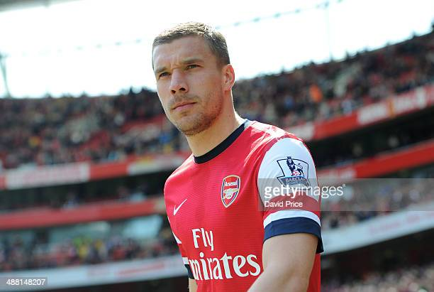 Lukas Podolski of Arsenal looks on before the match between Arsenal and West Bromwich Albion in the Brclays Premier League at Emirates Stadium on May...