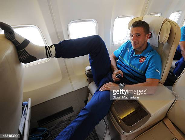 Lukas Podolski of Arsenal on the team plane at Luton Airport on September 15 2014 in St Albans England Photo by Stuart MacFarlane/Arsenal FC via...