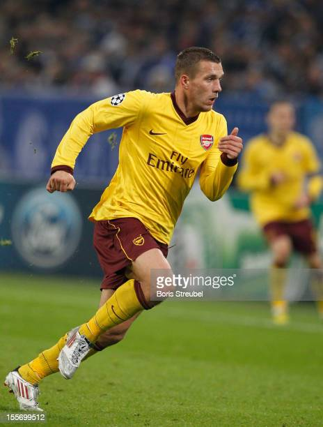 Lukas Podolski of Arsenal runs during the UEFA Champions League group B match between FC Schalke 04 and Arsenal FC at VeltinsArena on November 6 2012...