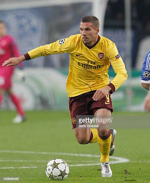 Lukas Podolski of Arsenal runs with the ball during the UEFA Champions League group B match between FC Schalke 04 and Arsenal FC at VeltinsArena on...