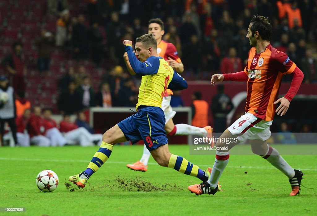 Lukas Podolski of Arsenal scores their fourth goal during the UEFA Champions League Group D match between Galatasaray AS and Arsenal FC at Ali Sami Yen Arena on December 9, 2014 in Istanbul, Turkey.