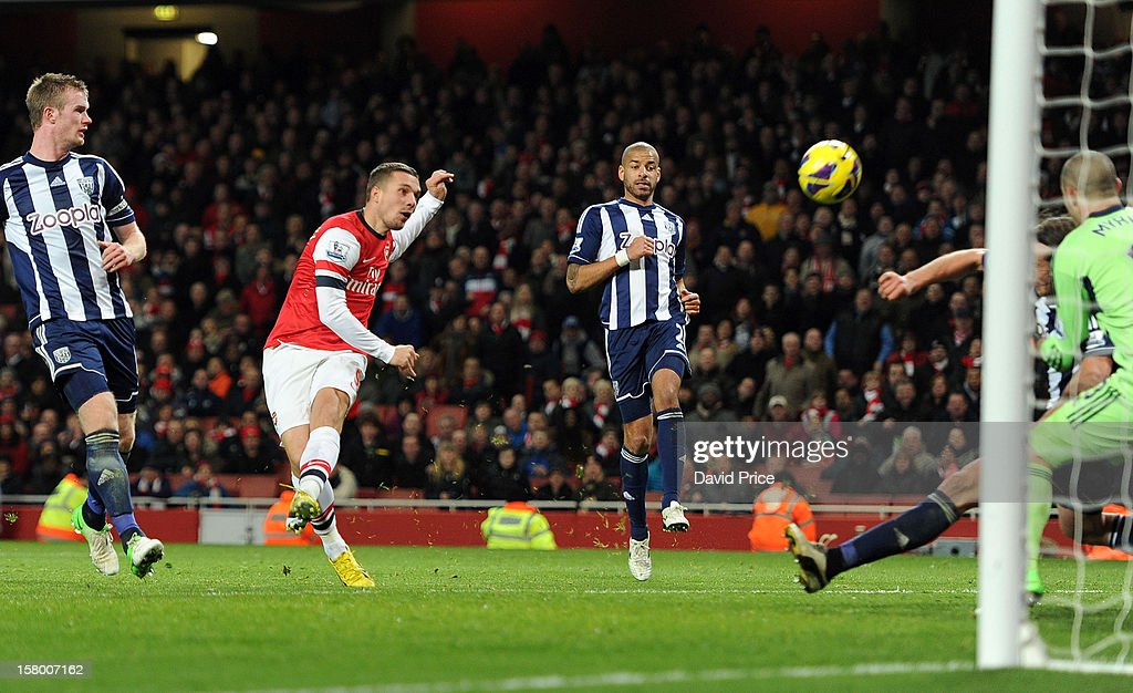 Lukas Podolski of Arsenal shoots over the bar during the Barclays Premier League match between Arsenal and West Bromwich Albion, at Emirates Stadium on December 08, 2012 in London, England.