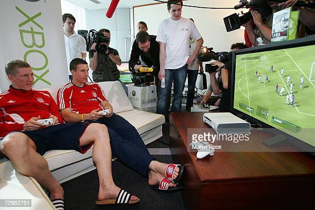 Lukas Podolski of Bayern beats Bastian Schweinsteiger at the FIFA 2007 Xbox game after the Bayern Munich press conference on January 09 2007 in Dubai...