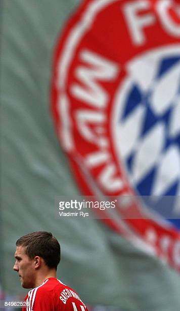 Lukas Podolski of Bayern enters the pitch prior to the Bundesliga match between Bayern Muenchen and 1 FC Koeln at the Allianz Arena on February 21...