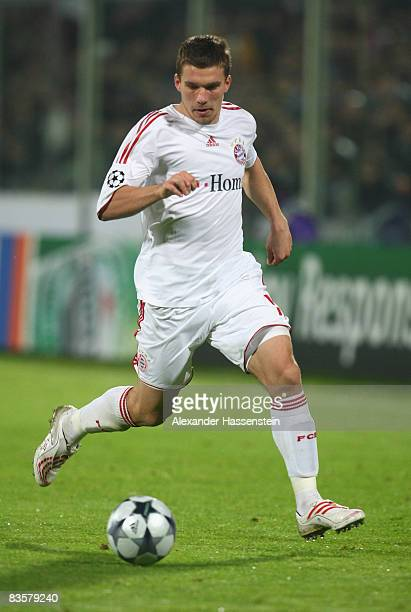 Lukas Podolski of Bayern Muenchen holds the ball during the UEFA Champions League Group F match between ACF Fiorentina and FC Bayern Muenchen at the...