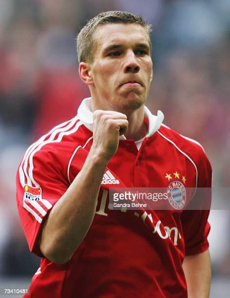 Lukas Podolski of Bayern Munich celebrates after scoring the first goal during the Bundesliga match between Bayern Munich and VfL Wolfsburg at the...