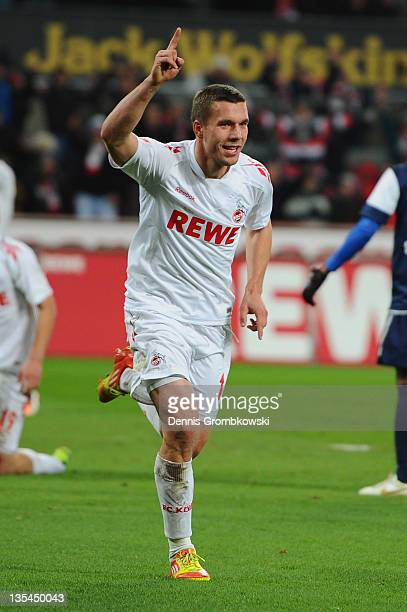 Lukas Podolski of Cologne celebrates after scoring his team's fourth goal during the Bundesliga match between 1. FC Koeln and SC Freiburg at...