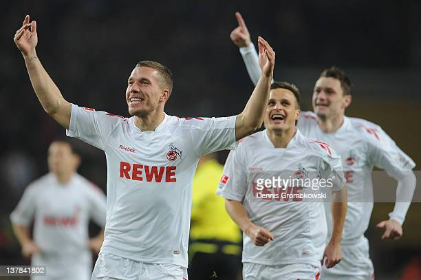 Lukas Podolski of Cologne celebrates after scoring his team's opening goal during the Bundesliga match between 1. FC Koeln and FC Schalke 04 at...