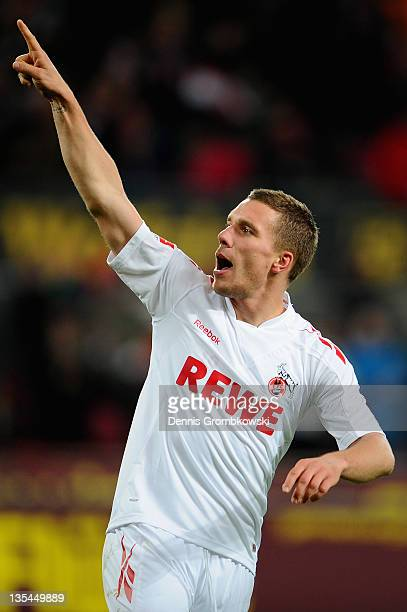 Lukas Podolski of Cologne celebrates after scoring his team's second goal during the Bundesliga match between 1 FC Koeln and SC Freiburg at...