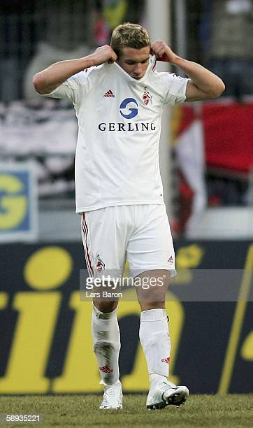 Lukas Podolski of Cologne looks dejected after loosing the Bundesliga match between 1 FC Cologne and Bayer Leverkusen at the RheinEnergie Stadium on...