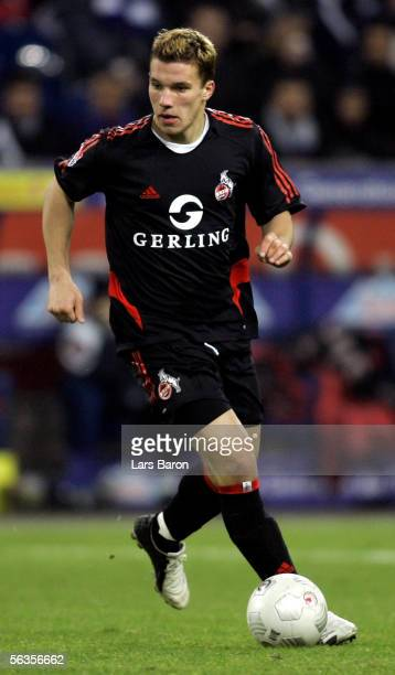 Lukas Podolski of Cologne runs with the ball during the Bundesliga match between MSV Duisburg and 1FC Cologne at the MSV Arena on December 6 2005 in...