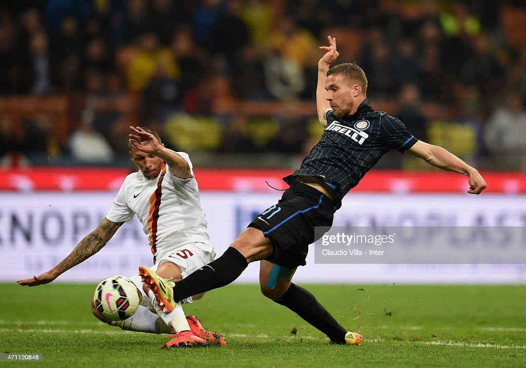 Lukas Podolski of FC Internazionale (R) in action during the Serie A match between FC Internazionale Milano and AS Roma at Stadio Giuseppe Meazza on April 25, 2015 in Milan, Italy.