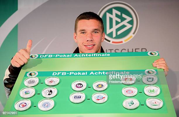 Lukas Podolski of FC Koeln shows the next Women's DFB Cup round of sixteen matches during the DFB press conference for the Women's DFB Cup Final 2010...