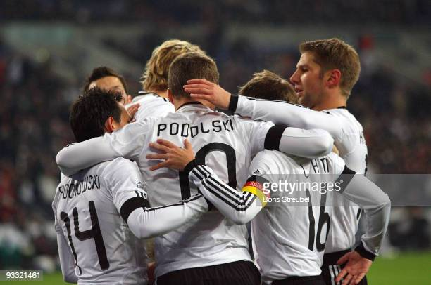 Lukas Podolski of Germany and his team mates Piotr Trochowski, Stefan Kiessling, Philipp Lahm and Thomas Hitzlsperger celebrate the first goal during...
