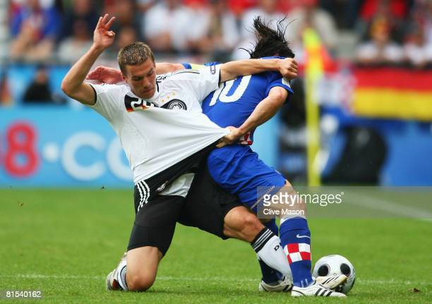 Lukas Podolski of Germany and Niko Kovac of Croatia battle for the ball during the UEFA EURO 2008 Group B match between Croatia and Germany at...