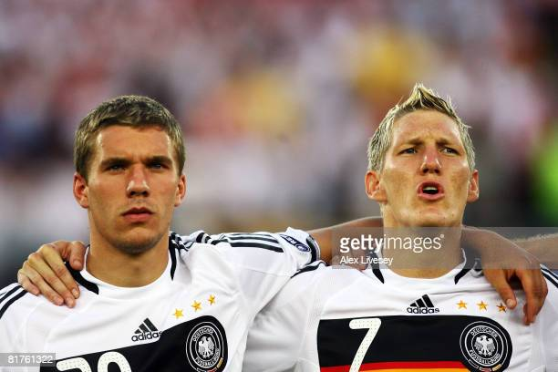 Lukas Podolski of Germany and team mate Bastian Schweinsteiger look on during the UEFA EURO 2008 Final match between Germany and Spain at Ernst...
