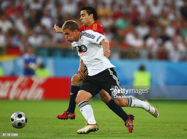 Lukas Podolski of Germany and Xavi Hernandez of Spain during the UEFA EURO 2008 Final match between Germany and Spain at Ernst Happel Stadion on June...