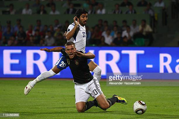 Lukas Podolski of Germany battles for the ball with Aris Isayev of Azerbaijan during the UEFA EURO 2012 qualifying match between Azerbaijan against...